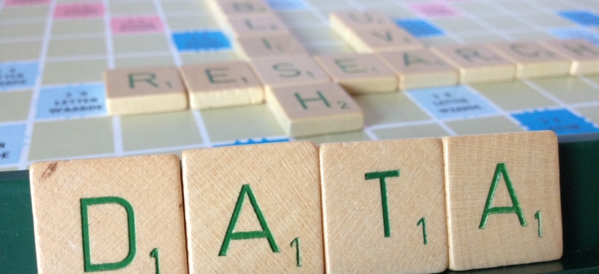 "Scrabble pieces spelling ""publish research data"""